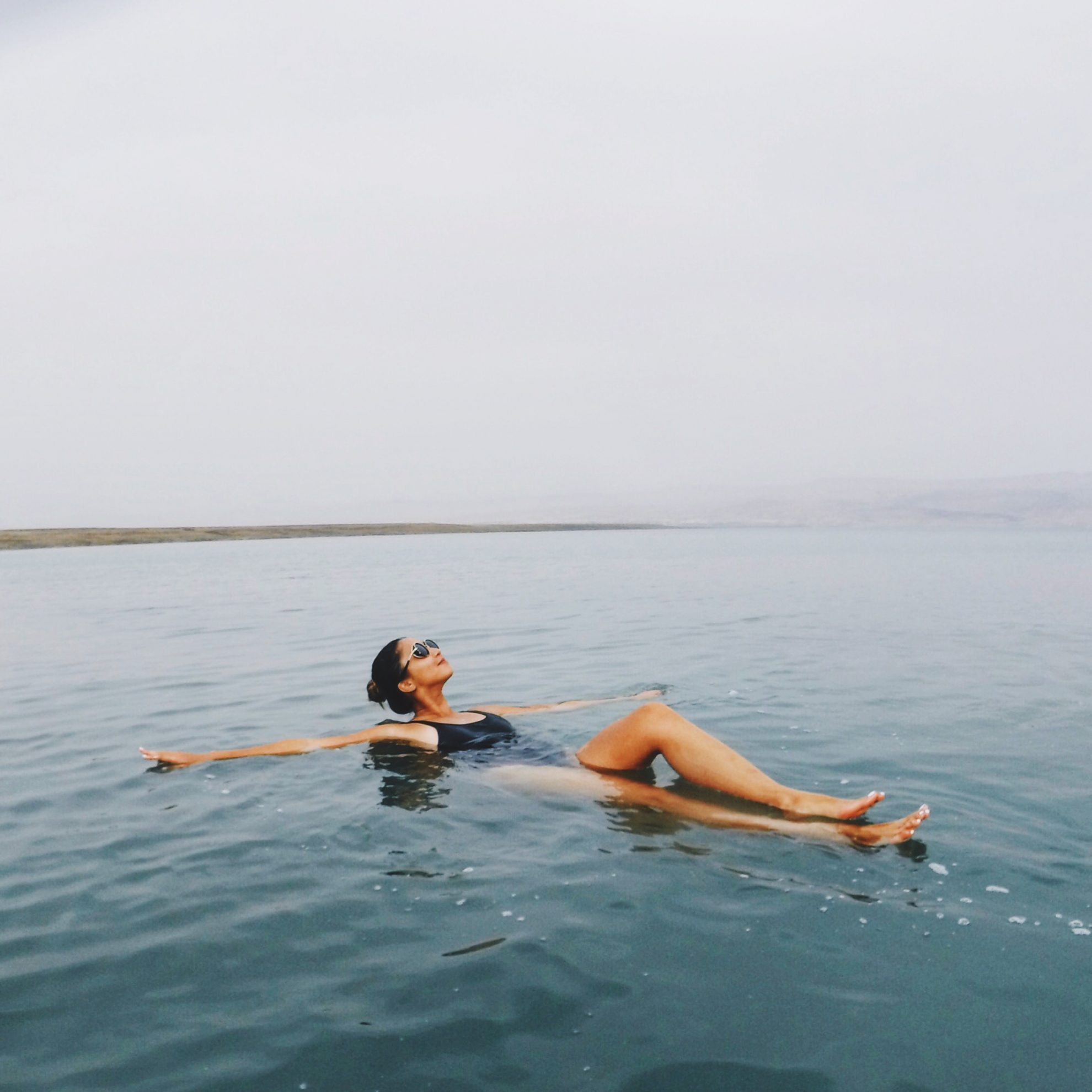 Tia Lacson at the Dead Sea wearing heysxy